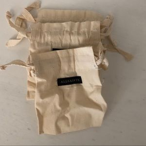 All Saints small jewelry dust bags - 3 pack